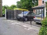 Ref: GT005 Folding Metal Gates for Sloping Driveway in Moston, Manchester